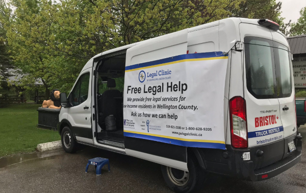 "Photo of white van with ""Free Legal Help"" written on the side"